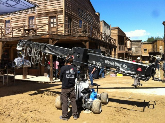 Camera man using Cranes for Film Production on wild west movie set