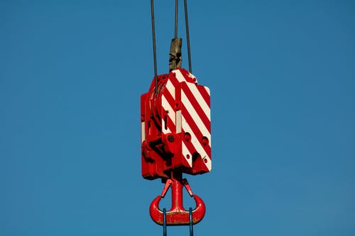 Suspended red crane hook