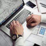 man on laptop using design software
